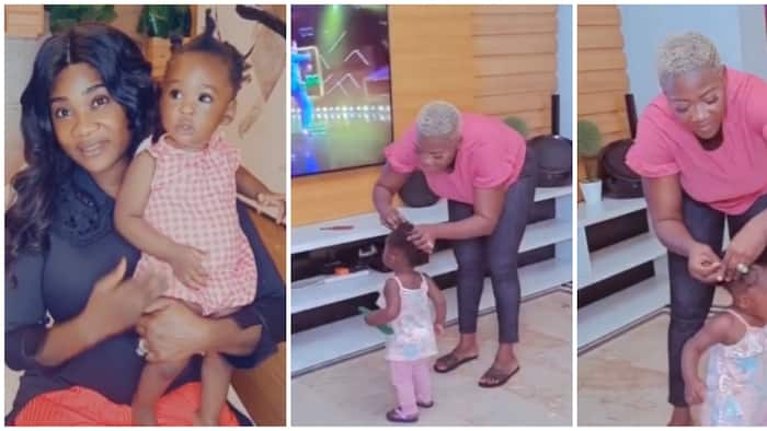Motherhood: Mercy Johnson struggles to make baby Divine's hair in cute new video