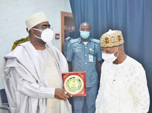 The head of NCS, Hameed Ali, receiving an award