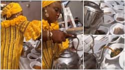 Video captures lady serving ewedu and gbegiri with kettles, Nigerians give mixed reactions
