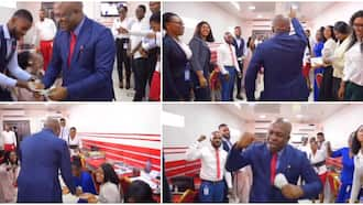 Nigerian billionaire surprises his workers, gives each one hard currencies, they fall to the ground in video