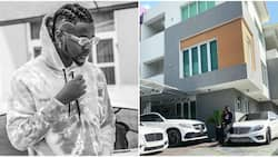 Kizz Daniel shows fans his expensive luxury rides and new mansion (photo)