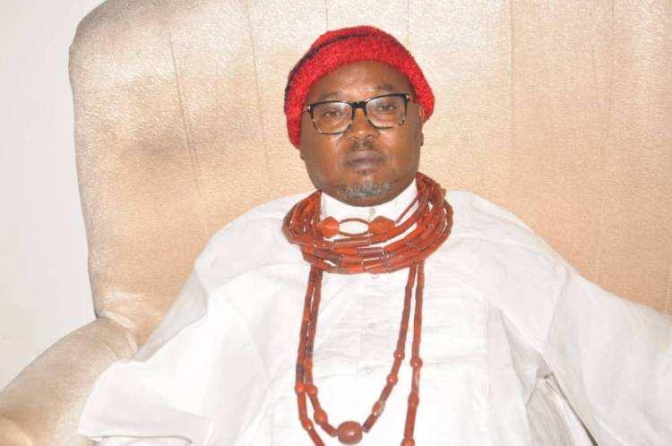 Chief Denis Omovie in his traditional attire