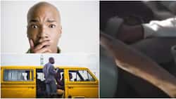 This is juju: Reactions as danfo driver stretches hand to the back to change gear sharing seat with passengers
