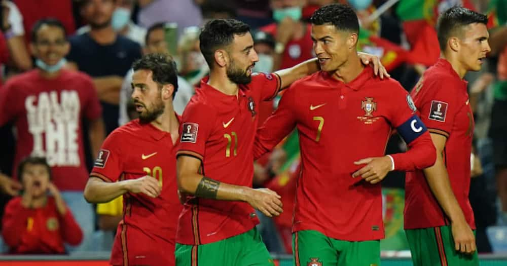 Bruno Fernandes of Portugal celebrates with teammate Cristiano Ronaldo after scoring a goal during the 2022 FIFA World Cup Qualifier match between Portugal and Luxembourg at Estadio Algarve on October 12, 2021 in Loule, Portugal. (Photo by Gualter Fatia)