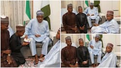 Pictures of Buhari sharing Naira notes with children cause stir on social media, see what Nigerians call the president