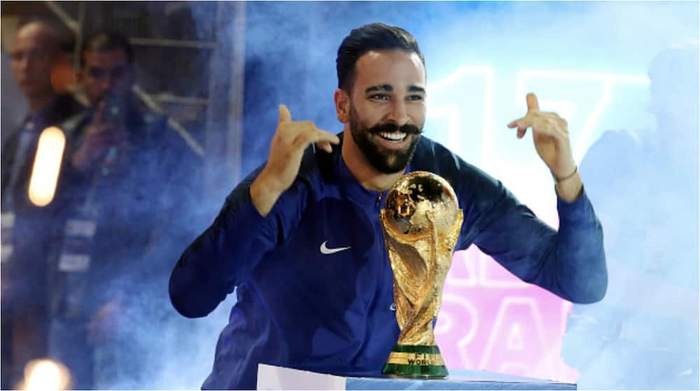 Adil Rami posses with the World Cup trophy in 2018