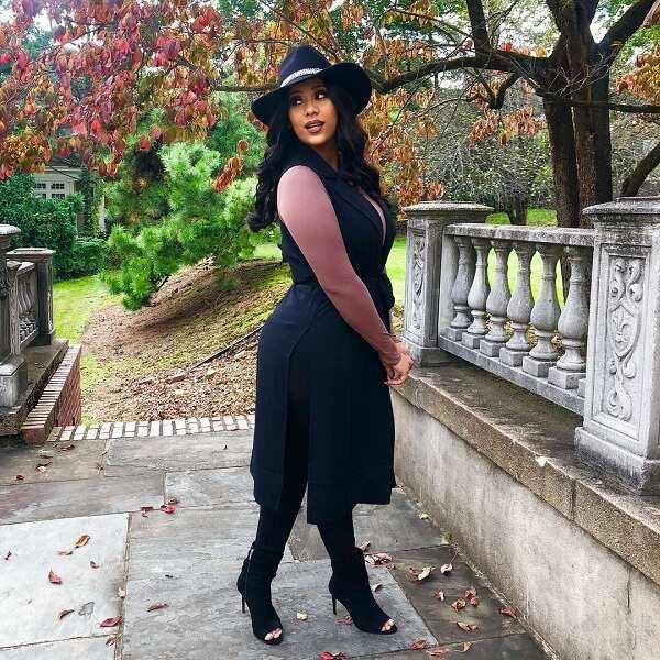 Cyn Santana poses in black outfit
