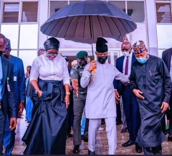 Viral Picture of VP Osinbajo Holding Umbrella by Himself during Rain Melts Heart; Many Praise Him