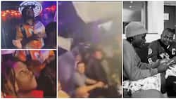 Cash rains as Olamide and Fireboy shut down club in US, video stirs reactions as Oyinbos watch