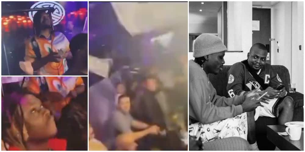 Olamide and Fireboy scatter club in US,rain cash as Oyinbo clubbers look on, video causes stir