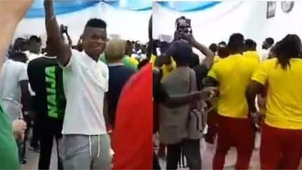 Super Eagles stars and coach Gernot Rohr party with Uganda players after stalemate (video)