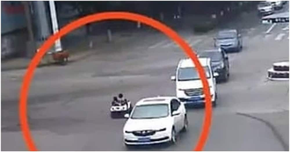 Boy caught on busy highway taking little girl for a ride in toy car