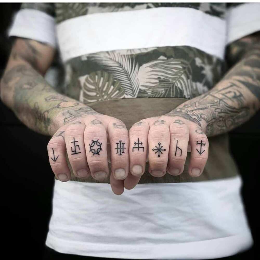 502b72ef3 50 finger tattoos ideas for men and women ▷ Legit.ng