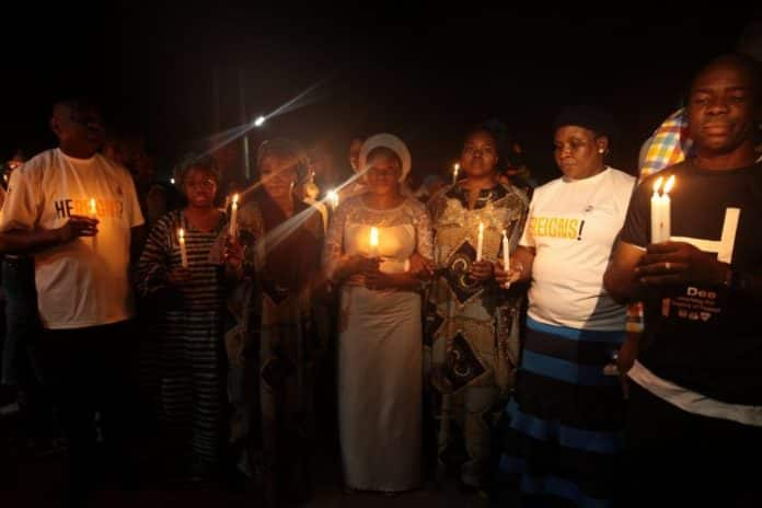 Photos emerge as hundreds hold candlelight procession for late Dare Adeboye