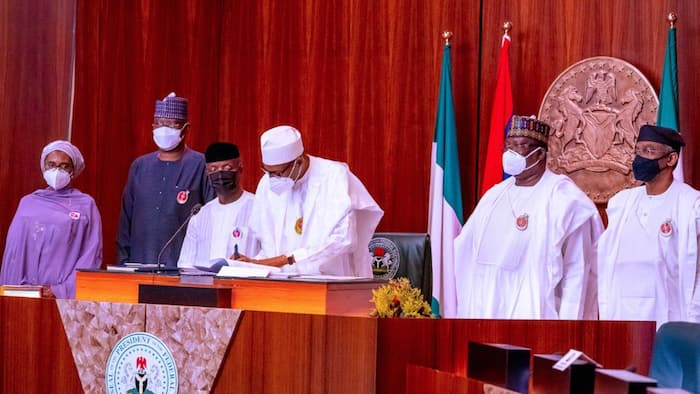BREAKING: President Buhari signs 2021 budget into law (photos)