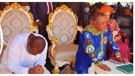 Photos emerge as Nigerian governors kneel in serious prayer while Father Mbaka prays