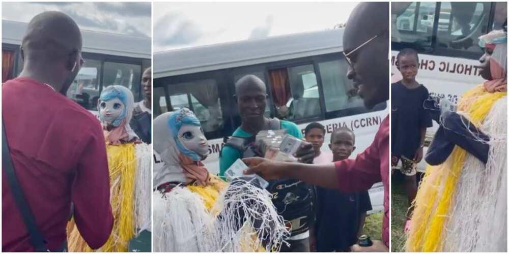 Masquerade Opens Mask After Mr Jollof Gifts Him Cash, Comedian Says: 'Na Poor Man Dem Dey Flog'