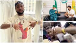Singer Davido rains cash on fuji musician Pasuma at an event, links up with Ogun governor