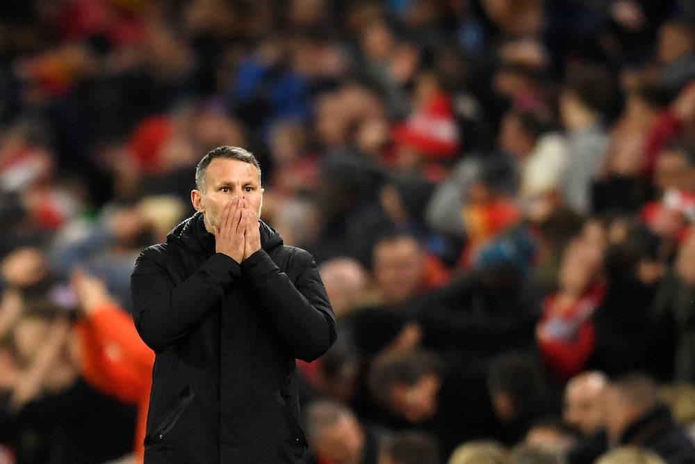 Ryan Giggs will step aside for Wales' next three fixtures after arrest