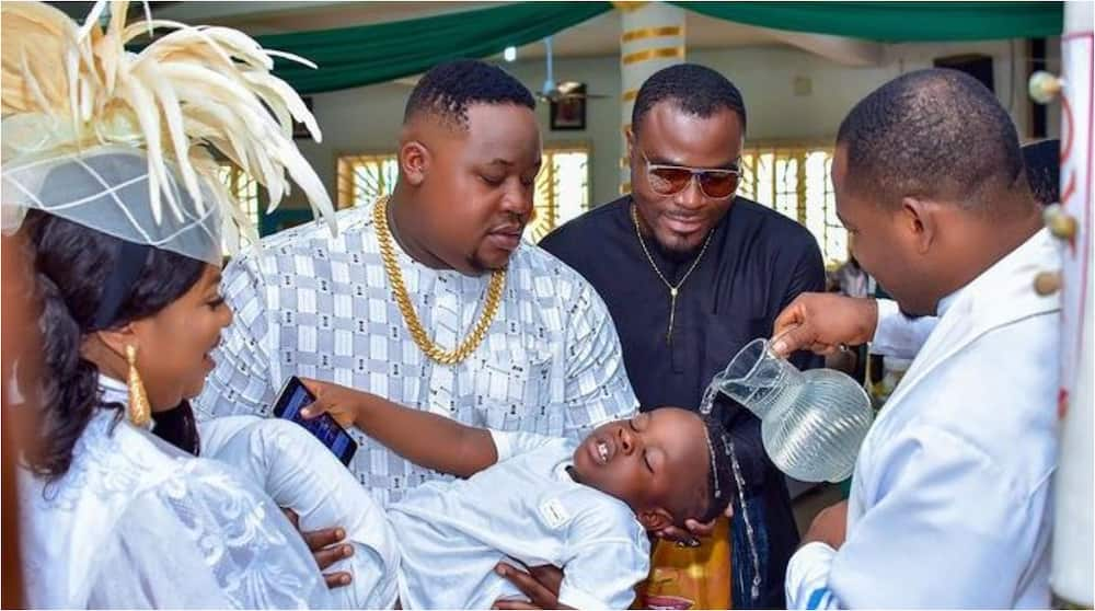 Rich ex-Super Eagles Star Stunned As Cubana Chiefpriest Son Gets Baptized in All-White D&G Designer Wear