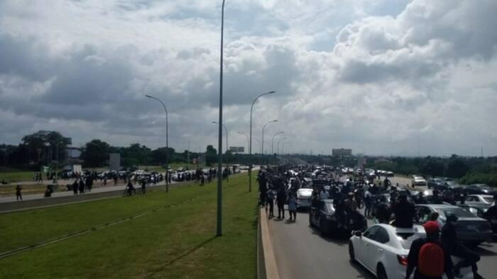Motorists stranded as BuhariMustGo protesters block Abuja airport road