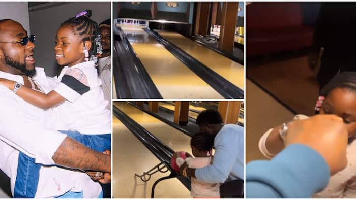 Davido happily 'chops knuckle' with Imade as she knocks down bottles during a bowling game