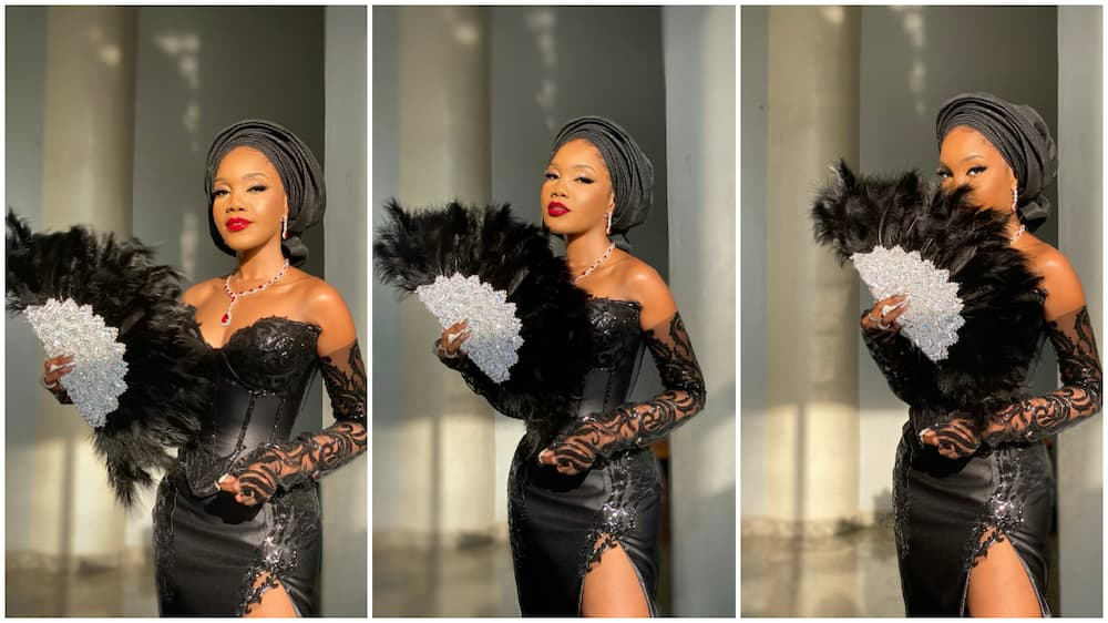 Nigerian tailor designs gown that comes with hand fan