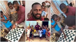 Nigerian man rescues kid from poverty, teaches him how to play Chess in Yoruba language, video stirs reactions