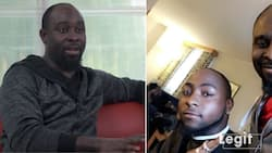 Meet PhD holder whose barbing business boomed after he gave Davido a stylish haircut (photos, video)