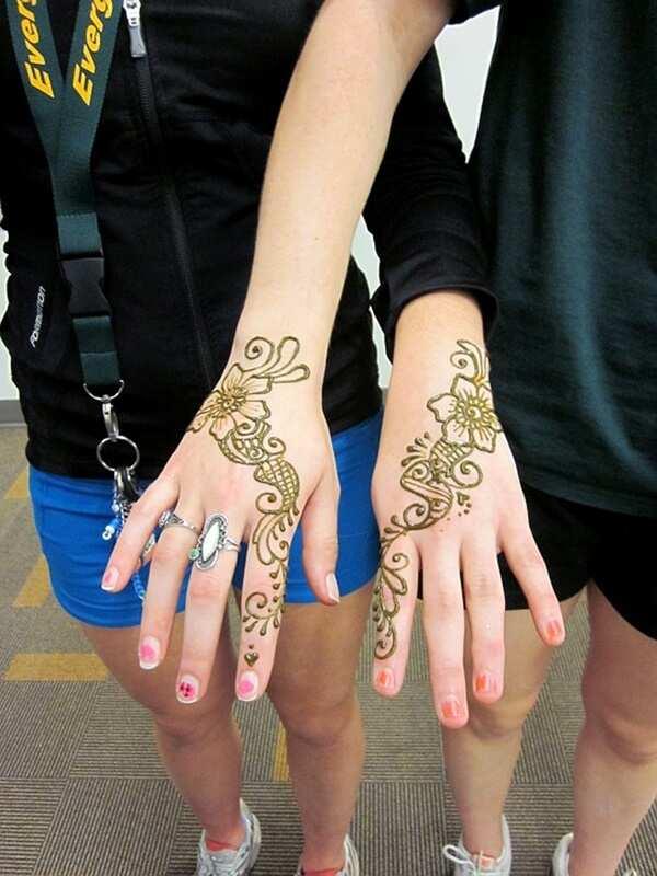 Elegant twin henna tattoos