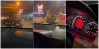 Video of Nigerian man hanging on to bonnet of lady's car because she didn't give him money sparks reactions