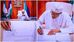 Breaking: Buhari finally signs Petroleum Industry Bill into law, photos show president's special signature
