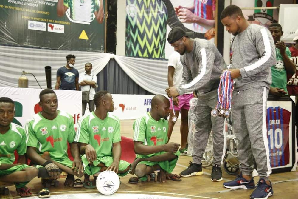 Peter Okoye presents medals to winners at the Girls and Para Soccer Championship