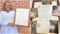 I wish my dad were alive - Lady says as she bags masters from Harvard, places father's photos on certificate