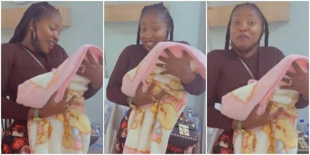 Anita Joseph lovingly holds Uche Ogbodo's baby