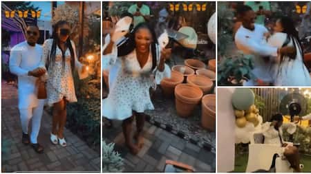 Tobi Bakre's wife removes shoes, prepares to run, after seeing guests at her surprise birthday party