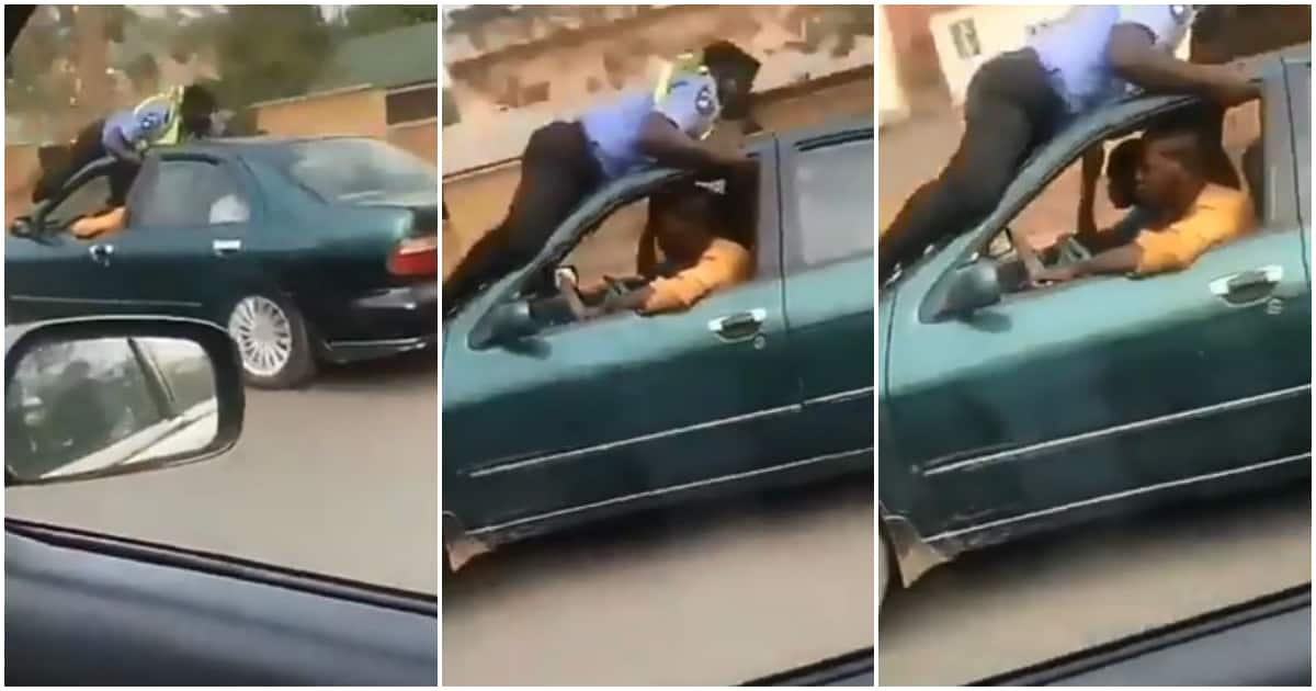 Nigerian policeman hangs for dear life on the roof of speeding taxi driver's car