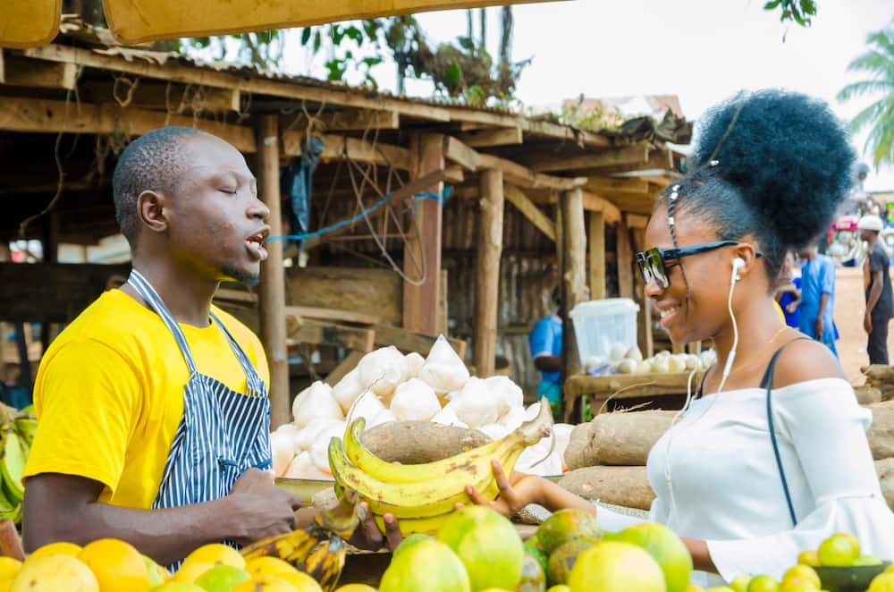 A Man Feeling Excited As He Sells To His Beautiful Customer