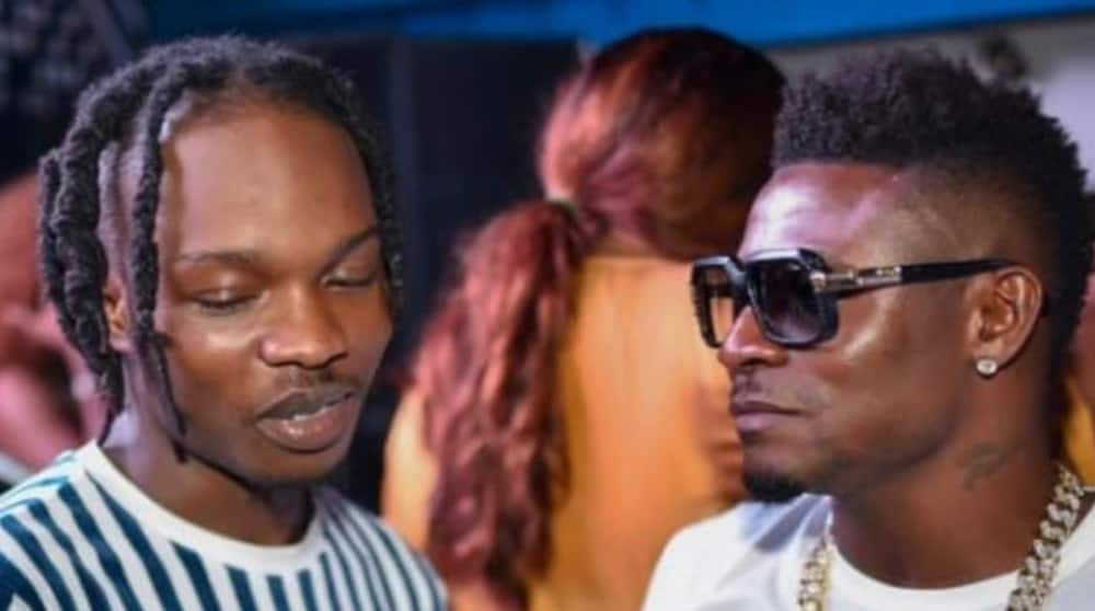 Former Super Eagles Striker Spotted Hanging Out With Nigerian Music Sensation Naira Marley