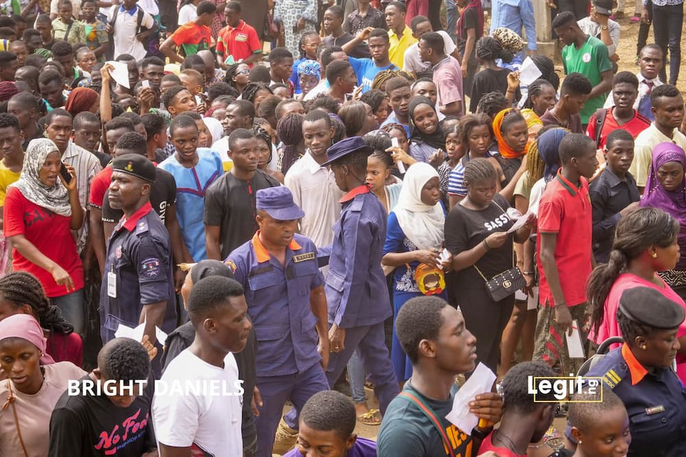 COVID-19: Again, Nigerians defy FG's restrictions, troop to NIMC for NIN
