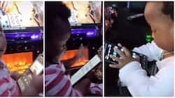 Reactions as little kid looks for Wizkid's song Essence on adult's phone herself, plays it in viral video