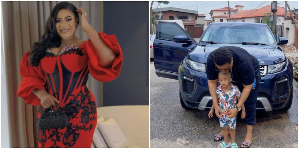 Nkechi poses with her godson in front of her car