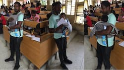 Flashback: Human kindness! This male lecturer babysits his student's twin babies so their mother can write her examination (photos)
