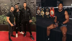 Heavyweight champions Anthony Joshua shows off stunning picture with Paul Pogba