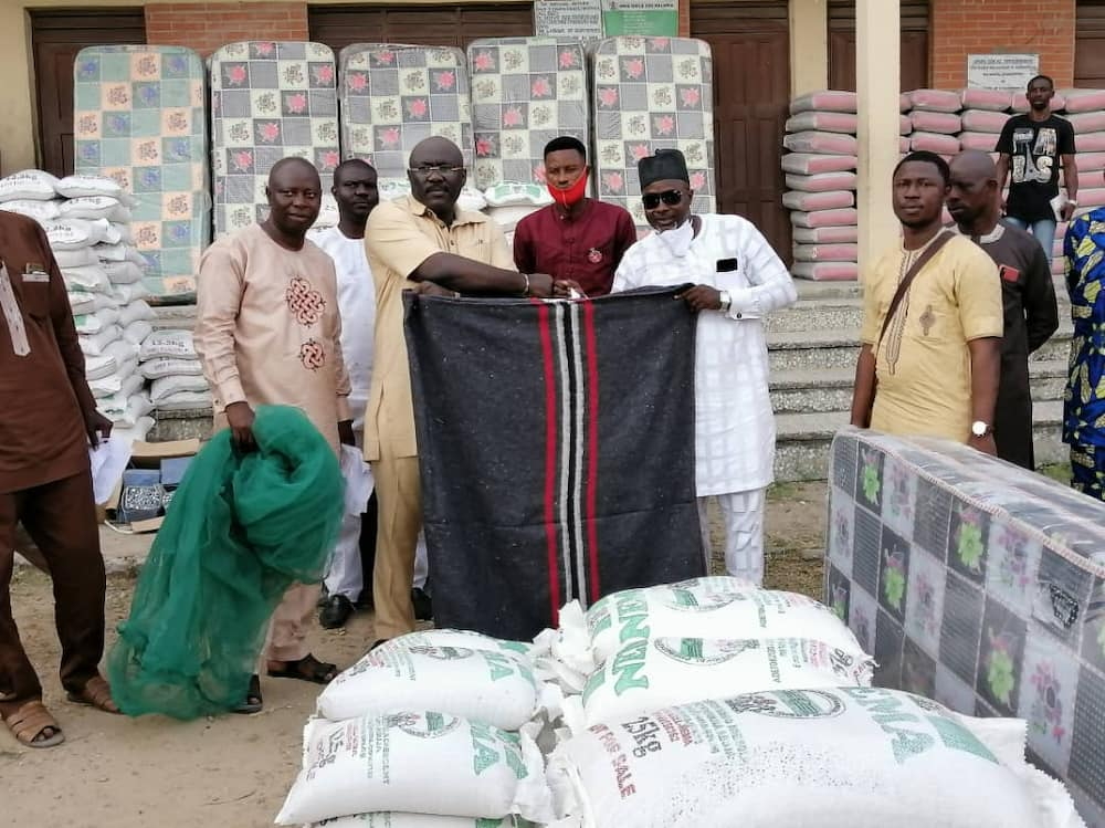 Rep member Mufutau Egberongbe 'blesses' constituents with gifts