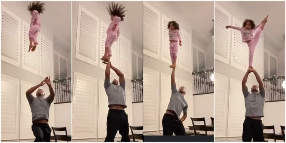 Little girl displays amazing skills as dad throws her in the air