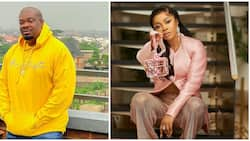 Play Coming by Naira Marley: Don Jazzy says as he 'laps' curvy media personality Toke Makinwa in photo
