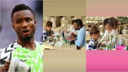 Super Eagles legend on daddy duties as he's spotted assisting his twin girls with their assignments