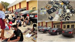 Clampdown in Enugu as EFCC arrests 30 Yahoo boys, laptops, cars, other items recovered (photos)