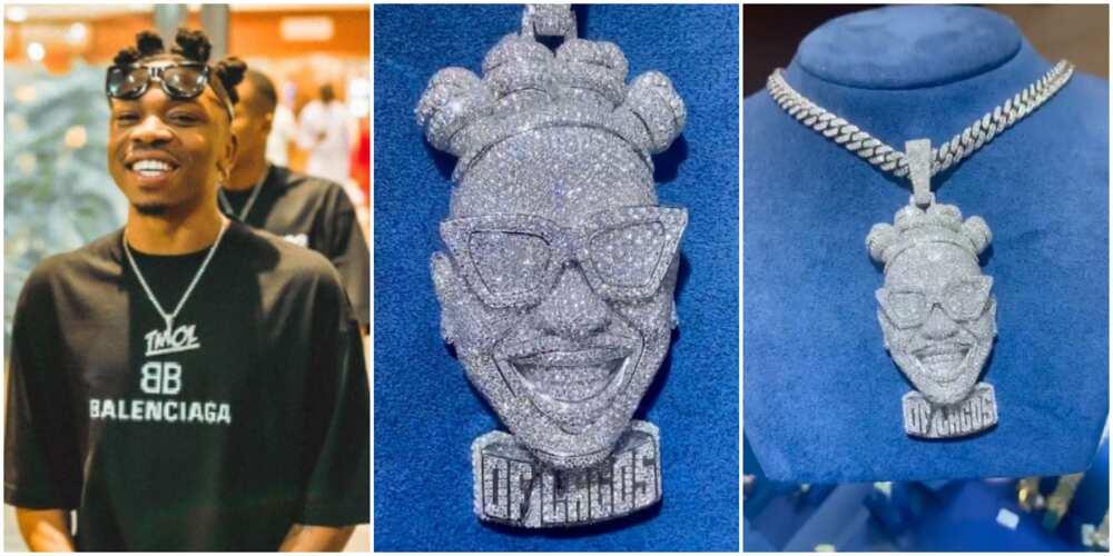 Mayorkun's diamond pendant.